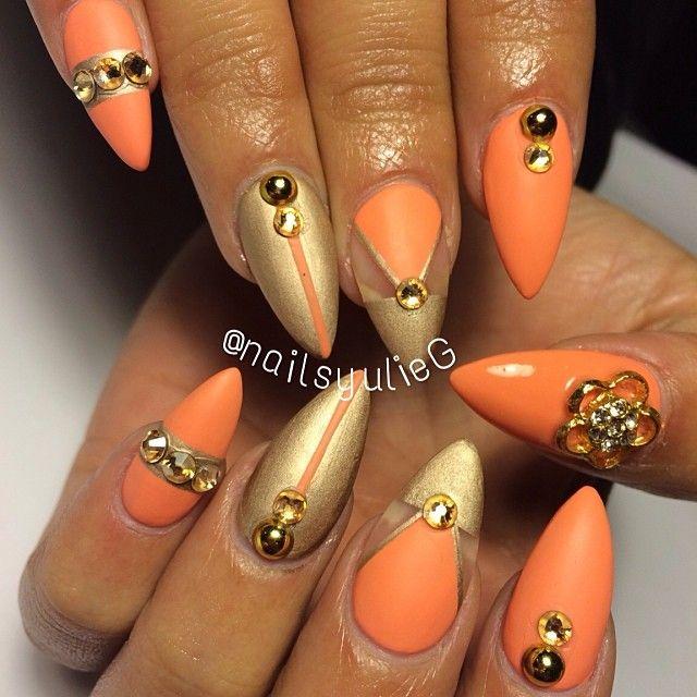orange gold matte almond stiletto nails clean