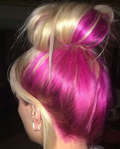 Messy blonde and fuchsia pink dyed hair in bun style