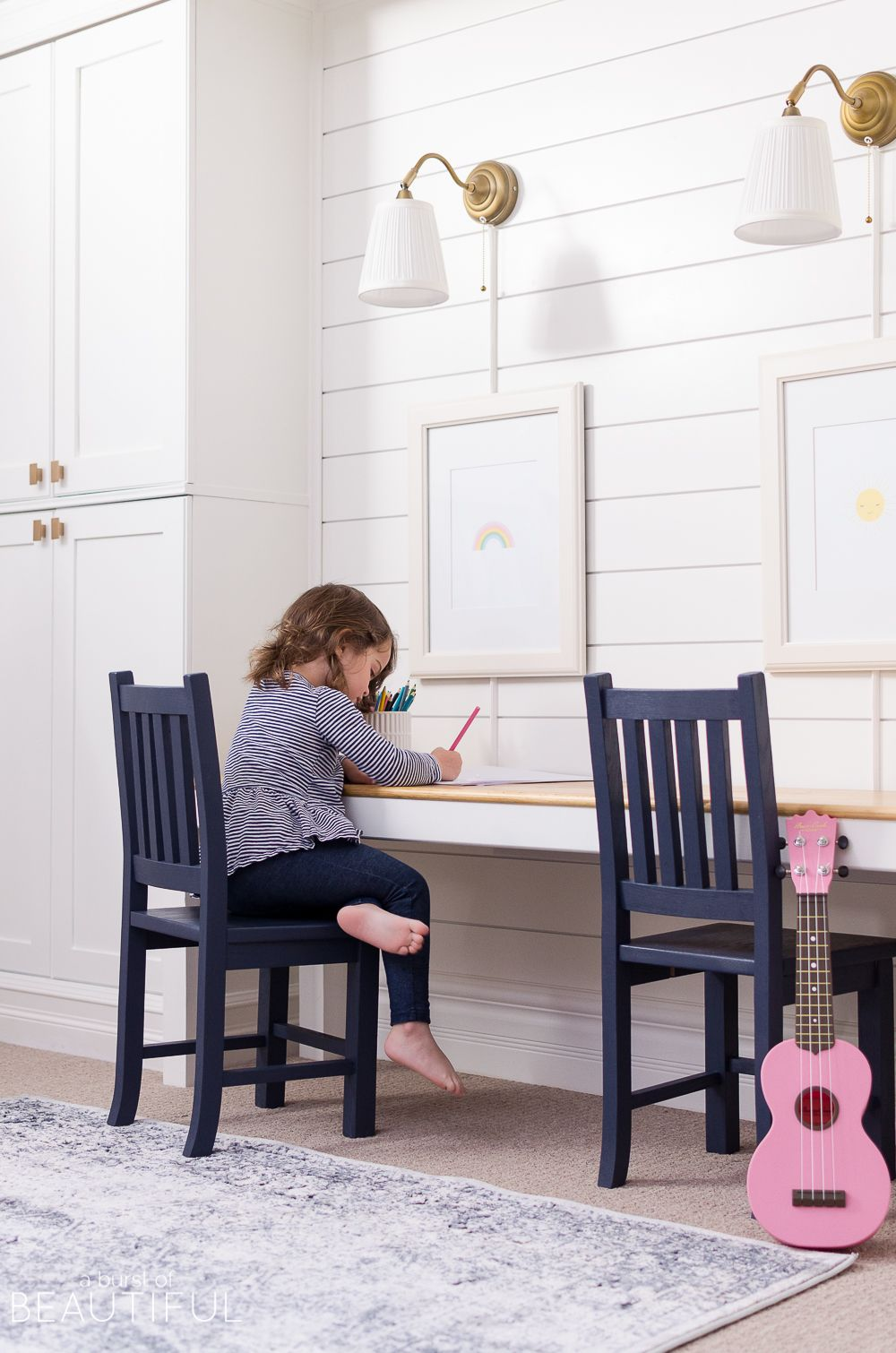 Hints Of Blue Pop Against Bright White Walls In This Cheerful Playroom,  Featuring A Kidu0027s