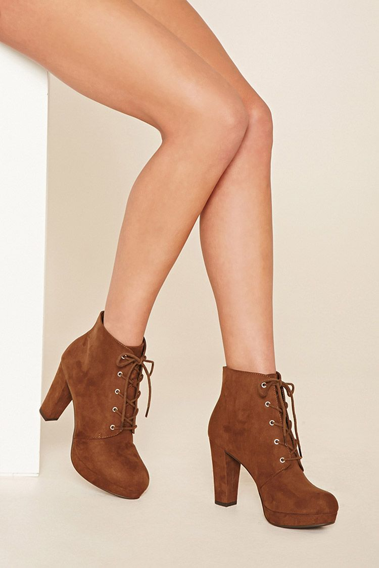 A Faux Suede Platform Ankle Boot Featuring A Round Toe A Lace Up