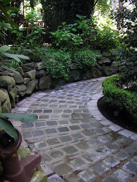 Lovely pathway bordered by a low stone wall. Labor Junction / Home Improvement / House Projects / Garden / Outdoor / House Remodels / www.laborjunction.com