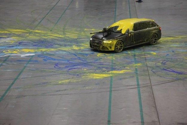 Two Audis RS 4 Avants rigged with paintball guns and cameras, duel in a decommissioned military...