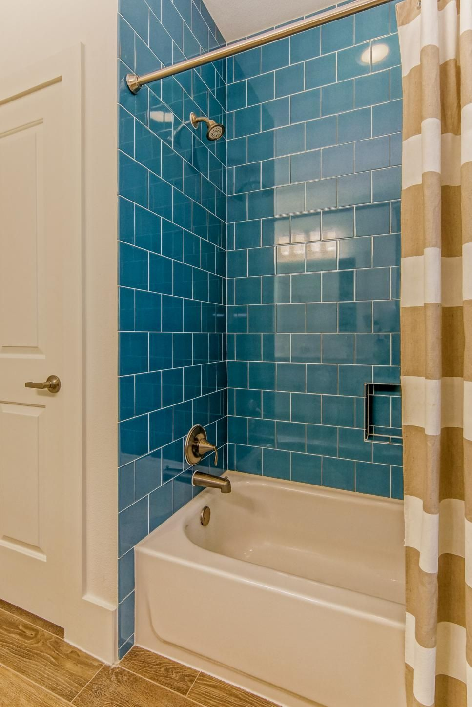 This+light+and+bright+bathroom+features+bold+turquoise+shower+tiles+ ...