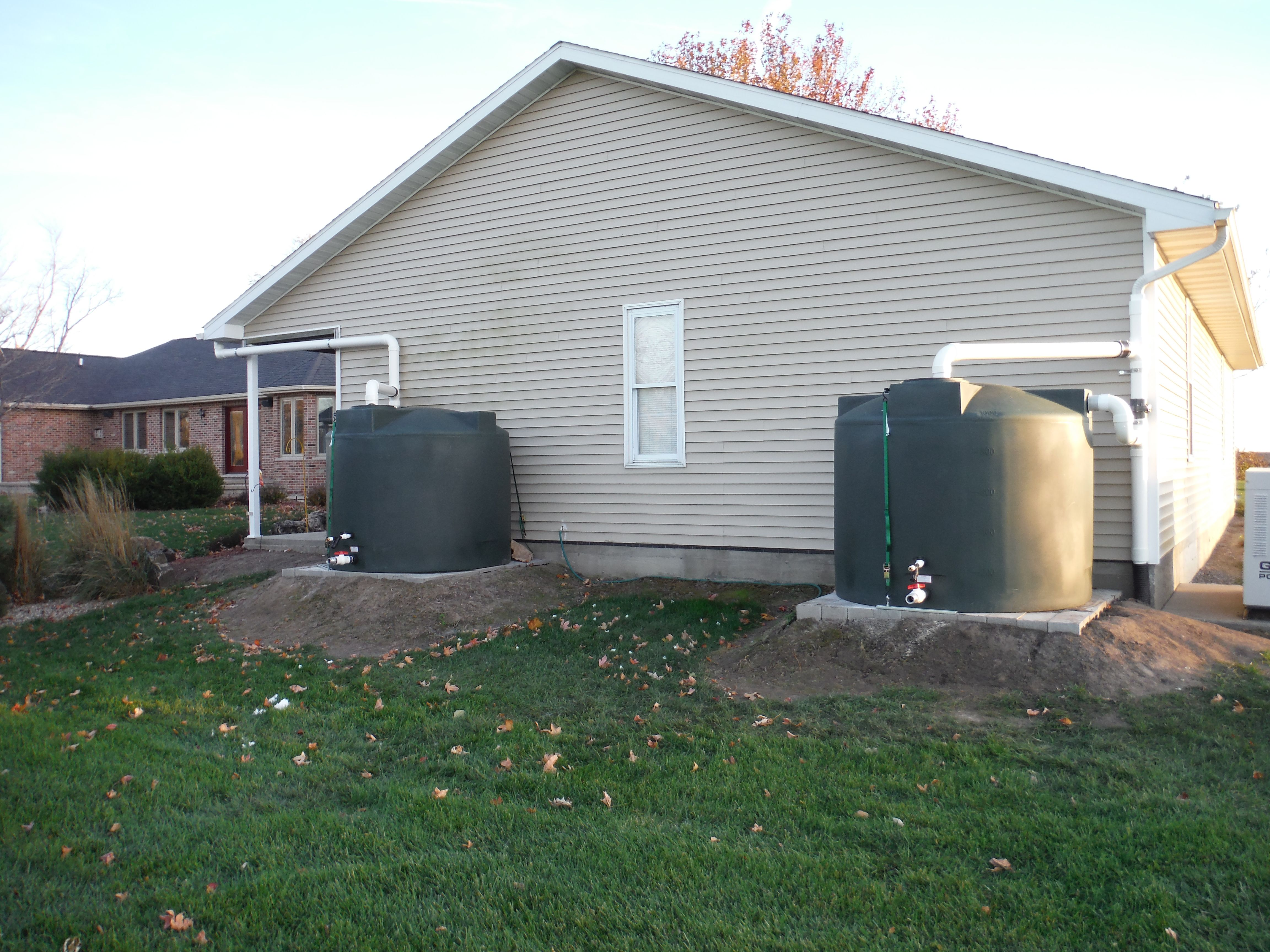 2 1000 Gallon Poly Mart Rainwater Tanks Installed In Illinois These Tanks Provide The Bulk Of Rainwater Harvesting Rainwater Harvesting System Organic Yard