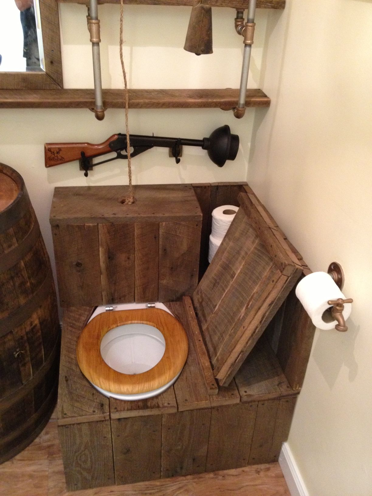 Barrel sink rustic toilet opened the ultimate redneck for Outhouse bathroom ideas