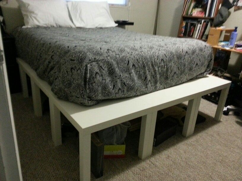 Queen bed platform made from ikea lack end tables. Total cost, under $100. I added a lack floating shelf as a small bedside table. I will also use baskets for storage under the bed for a more minimized look.