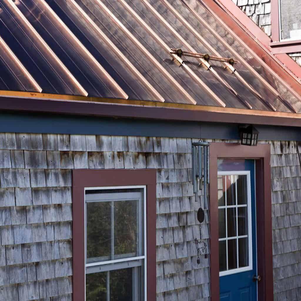 Interlock Standing Seam Roof Historic Wood Shake House Standing Seam Standing Seam Roof Metal Roof