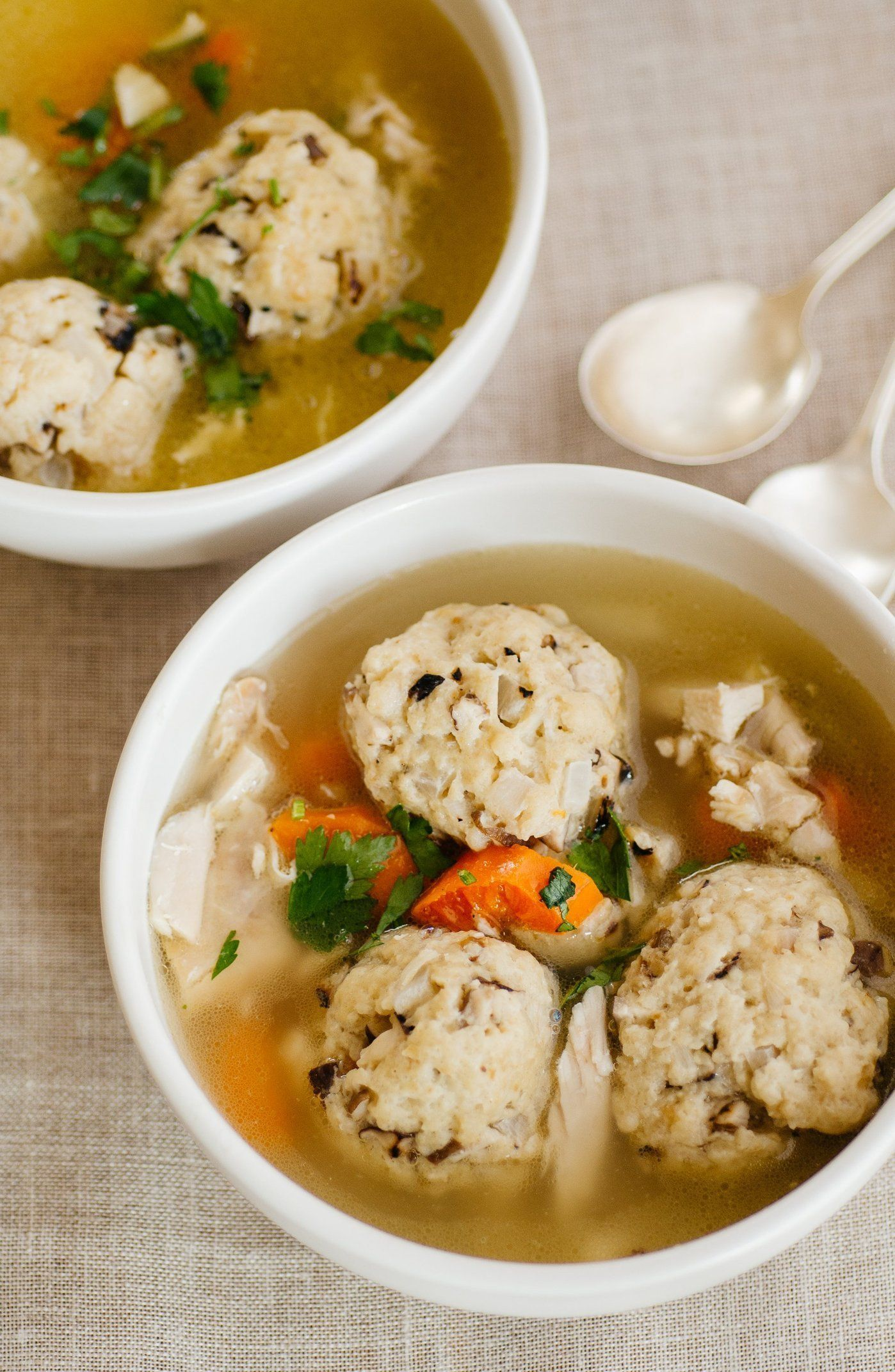 """I am all for getting creative in the kitchen, but sometimes, you just don't want to mess around with a classic. Take chicken soup. Whether you call it """"goldene yoich"""" (golden broth in Yiddish), """"Jewish Penicillin,"""" or just plain old soup, not much can top the basic, soul-satisfying combination of tender chicken, carrots, celery, and onions swimming in soothing broth.   But you can bring a touch (just a touch!) of something new to the classics, like with these savory, intensely delicious…"""