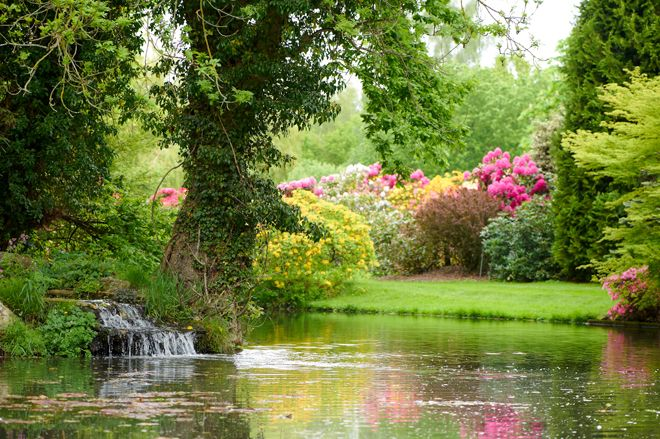 Colourful Gardens Complete With A Lake At Rivervale Barn Wedding Venue In Hampshire