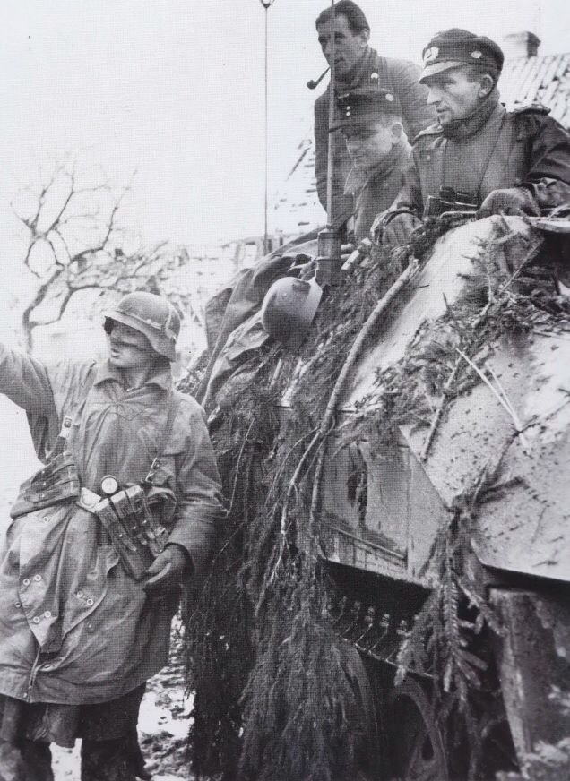 Soldiers from 116th Panzer Division were halted on a road to check position during  Battle of the Bulge