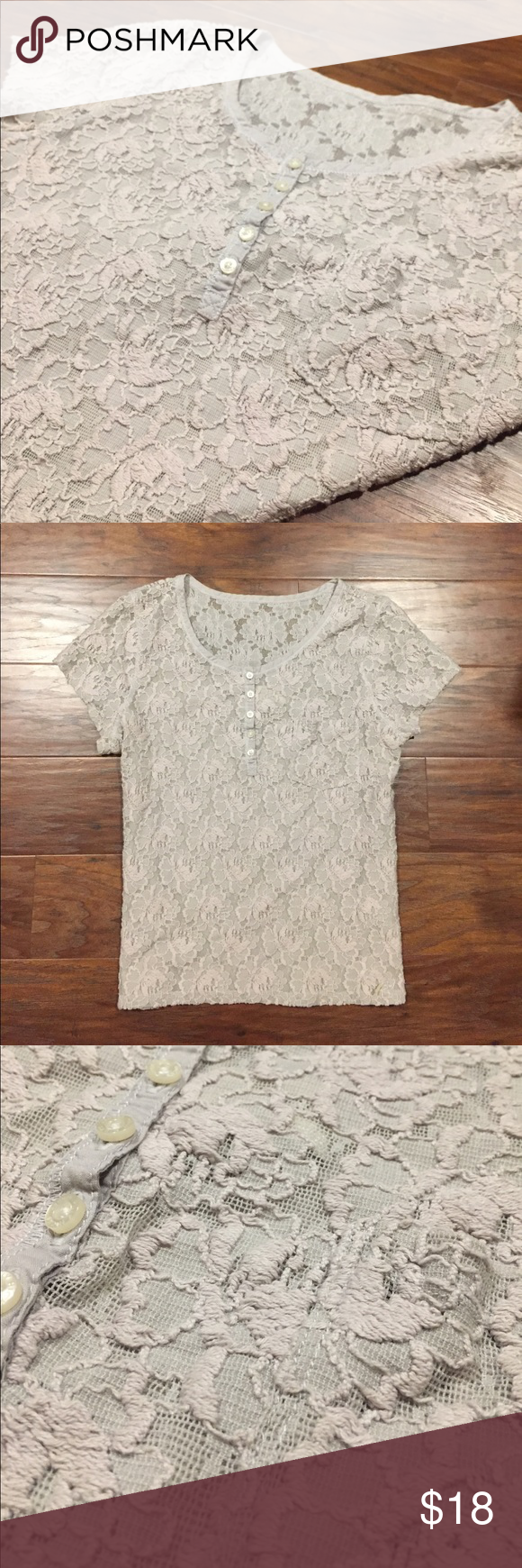 Floral Blouse BEAUTIFUL gray floral Blouse, half buttoned from Gilly Hicks. Beautiful Blouse and very flattering! Selling because it's too big on me (I'm now a size small) Gilly Hicks Tops Blouses