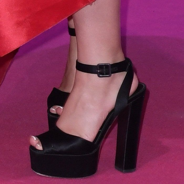 9774924da9b862 Camila Cabello shows off her feet in black platform Betty sandals from  Giuseppe Zanotti
