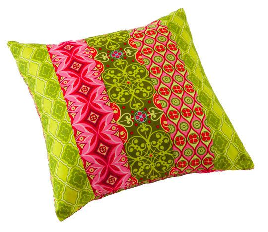 Piece rectangle strips to create a square pillow cover.