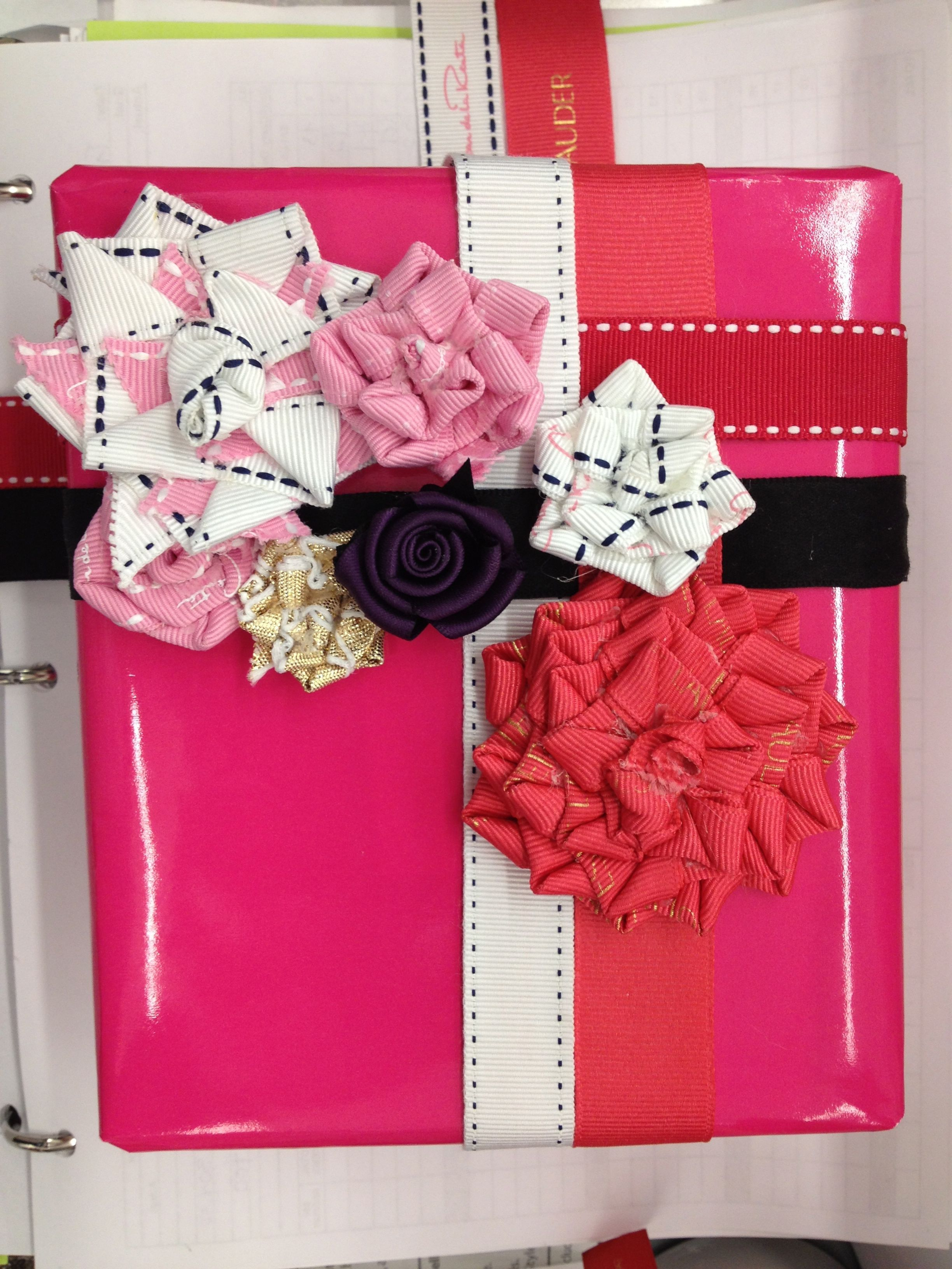 Birthday gift wrapped with roses made from twisted ribbons. The ribbons, when removed, can be used as headbands.