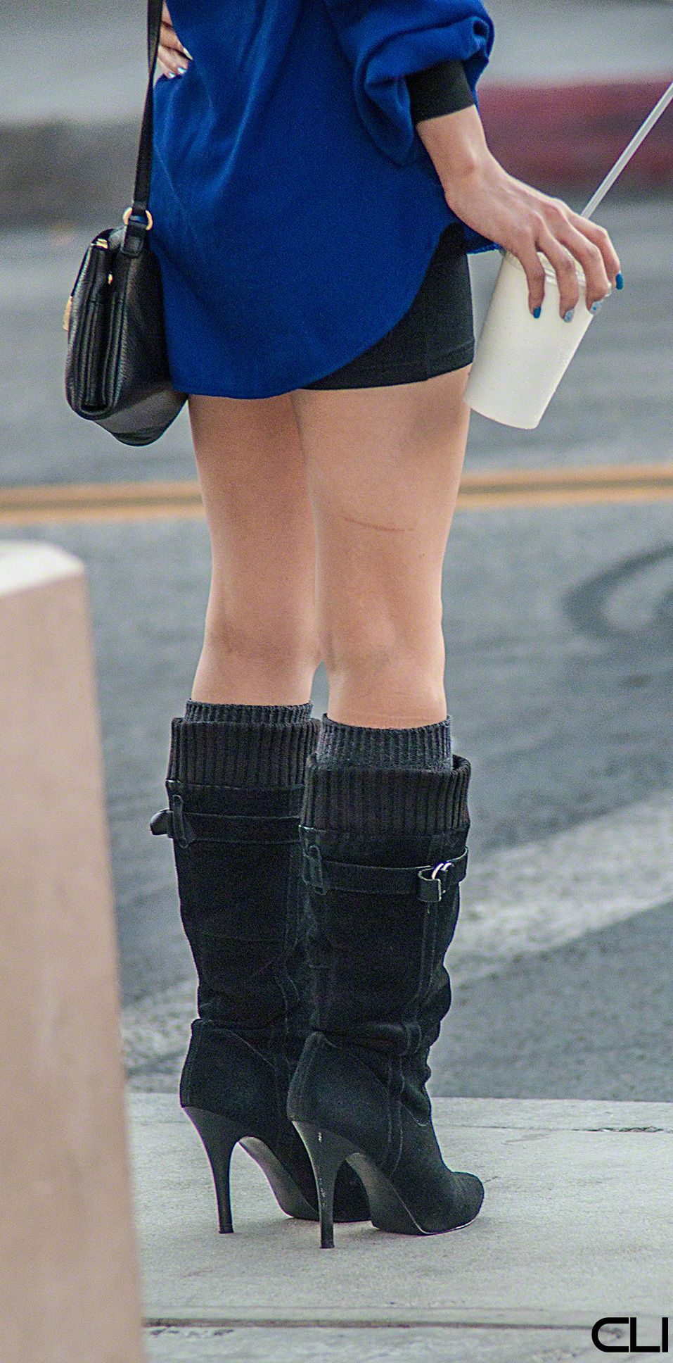 High heeled black suede boots with soft tops (along with high wool socks keeps your feet warm.. if not much else)