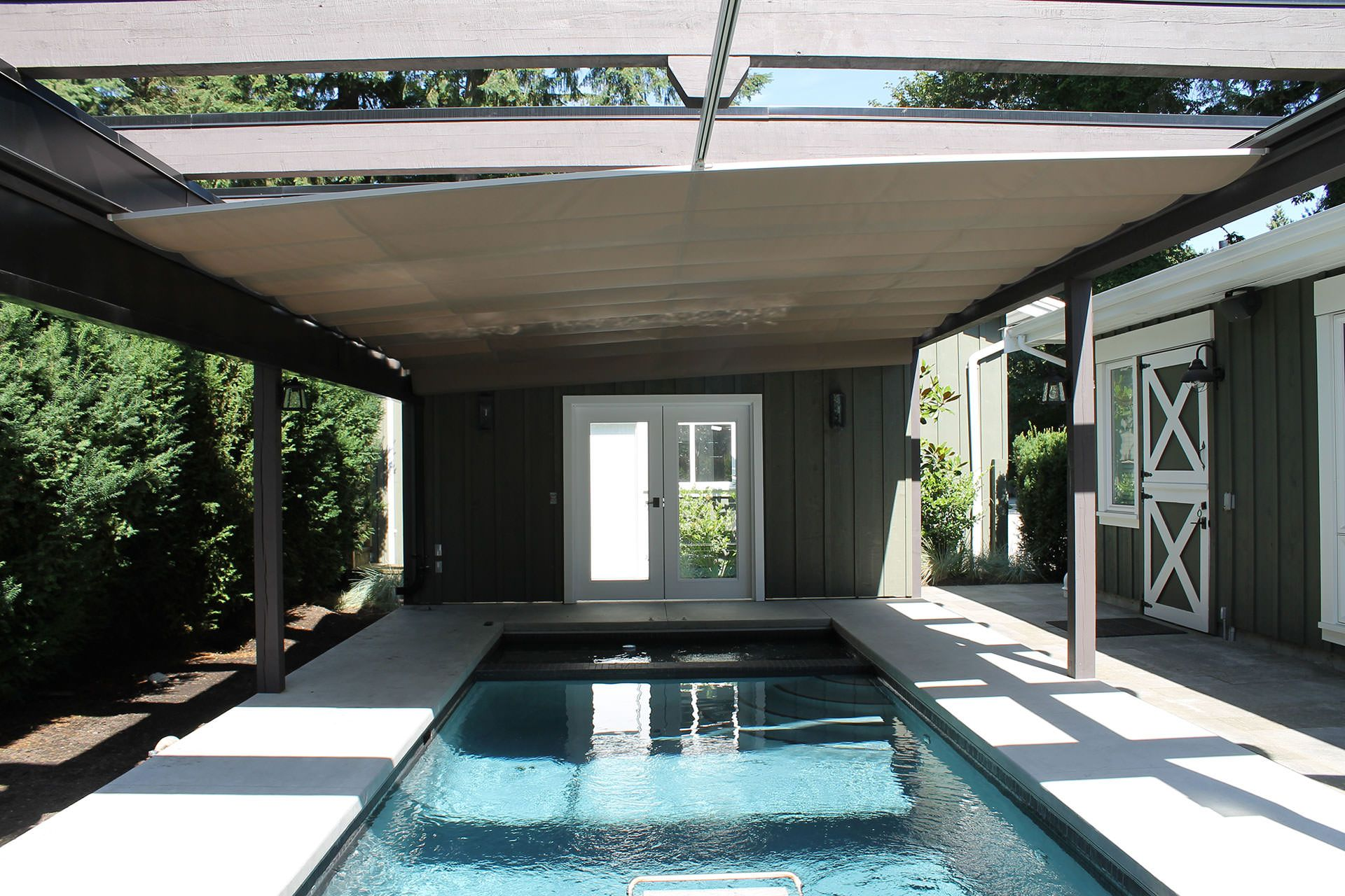 shadefx gives a new meaning to retractable pool covers with this