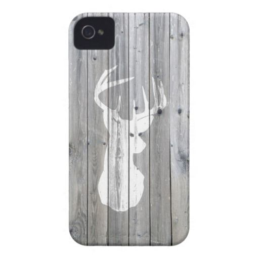 an unique, elegant, hipster and whimsical design of this vector silhouette design of a white deer head with antlers on a cool, urban grey vintage wood photo print background,