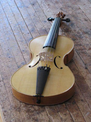 http://www.alcarruthluthier.com/violinFamilyInstruments/folkViola/newFolkViolaWithVolute.htm