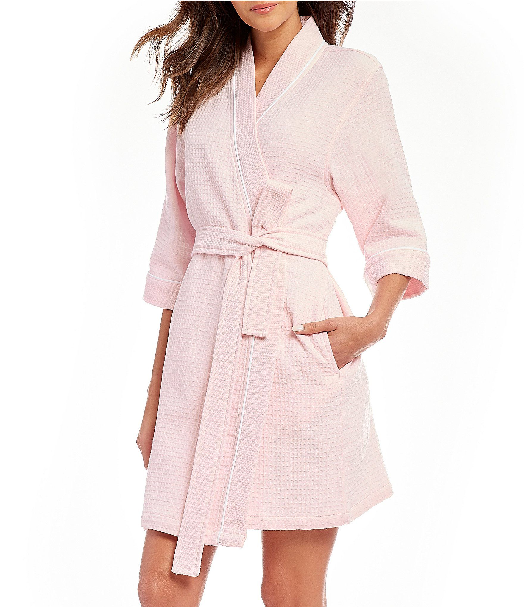 From Sleep Sense, this robe features:Soft textured waffle Banded collar neckline3/4 sleevesContrast piping trimTie beltApprox. 38