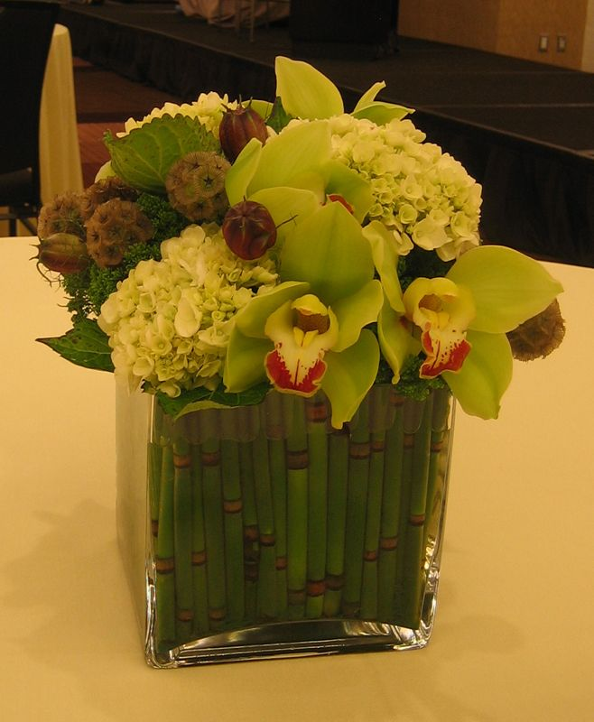 This Is A Cube Vase Floral Arrangement That Features Green Cymbidium Orchids And Hydrangea See Our Entire Pink Orchids Floral Arrangements Flower Arrangements
