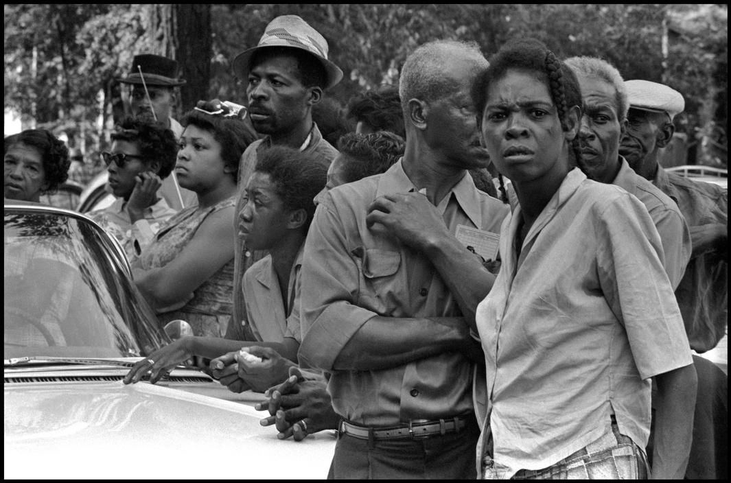 Birmingham, Alabama. 1963. The Sixteenth Street Baptist Church bombing. Crowds wait along the funeral route.