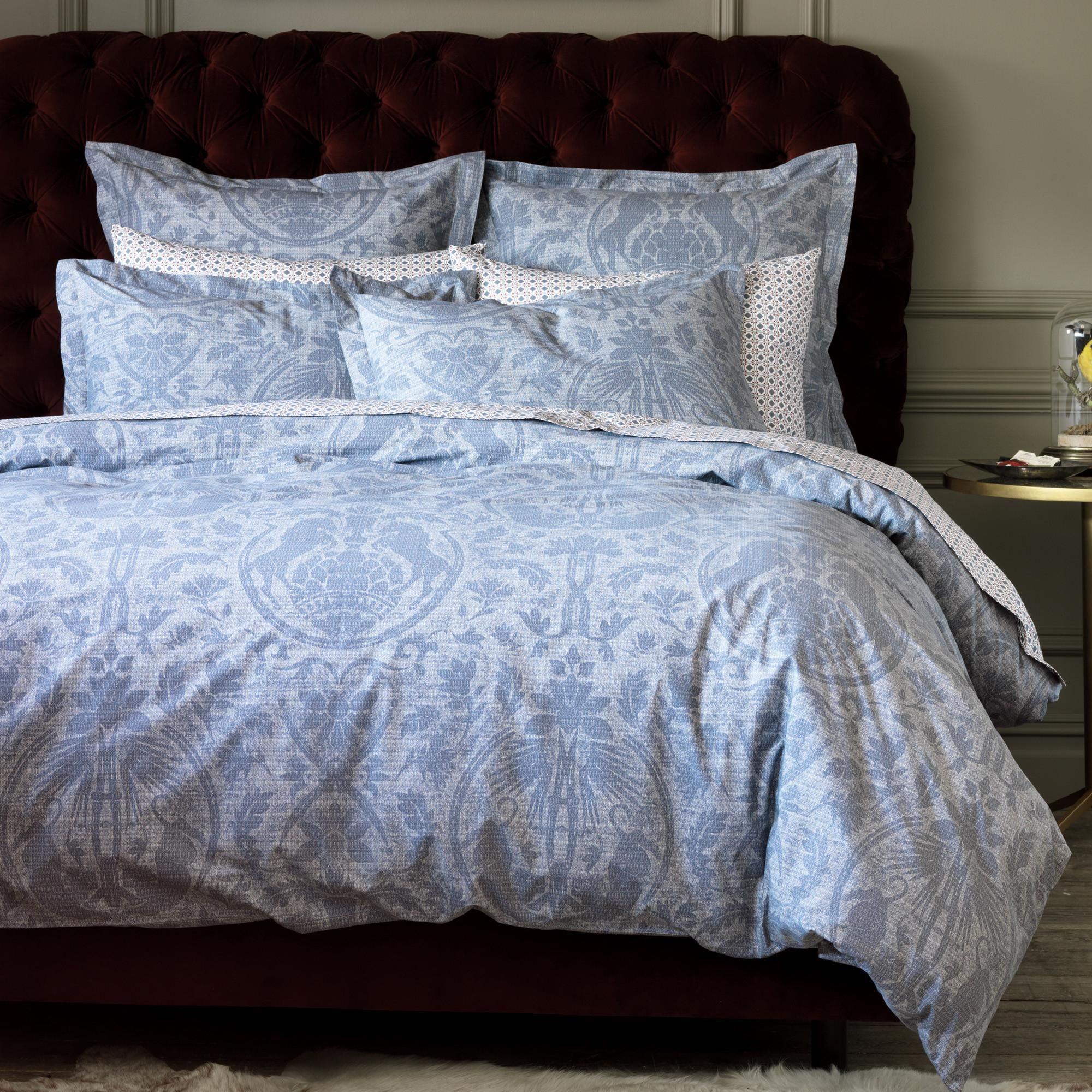 Studio Faves: Royal Blues. Chateau Duvet Cover | Luxury is in the details of this timeless-meets-modern duvet. Drawn to the intricate details of traditional damask and beautiful patina of vintage wallpaper, our designers discretely layered floral, decorative and animal elements for a truly unique design. The rich flint ground and faint pearl print create a textured, antique feel that only adds to the regal feel of our Chateau duvet.