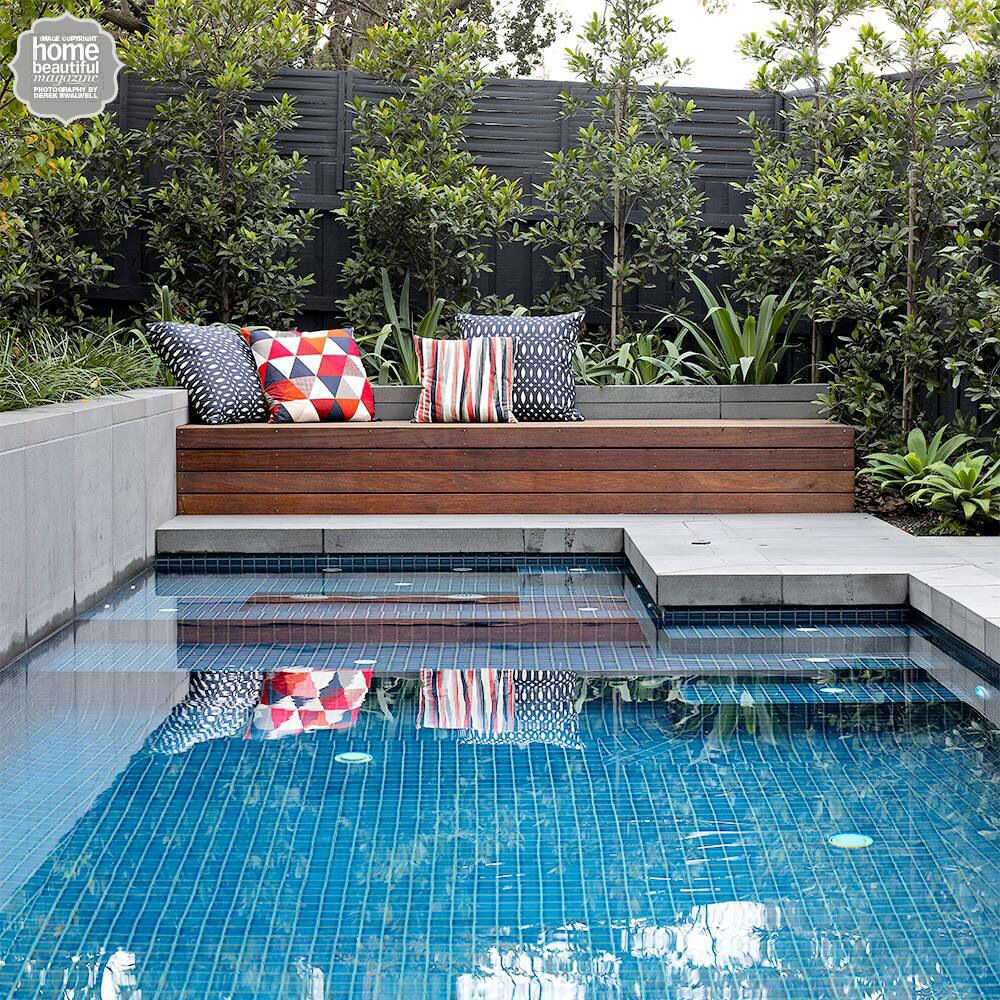 Timber Day Bed With Colourful Cushions By The Pool