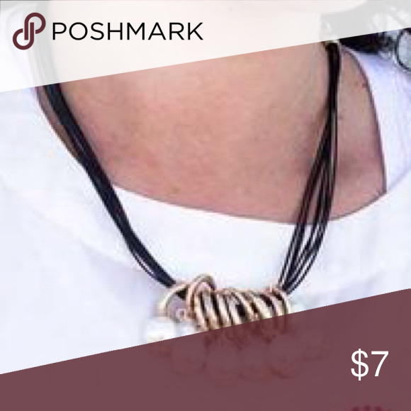 Black chord with white pearls necklace Cute black chord with white pearl necklace.    Super fun ! Bundle any of my jewelry items 5 for $25 Jewelry Necklaces