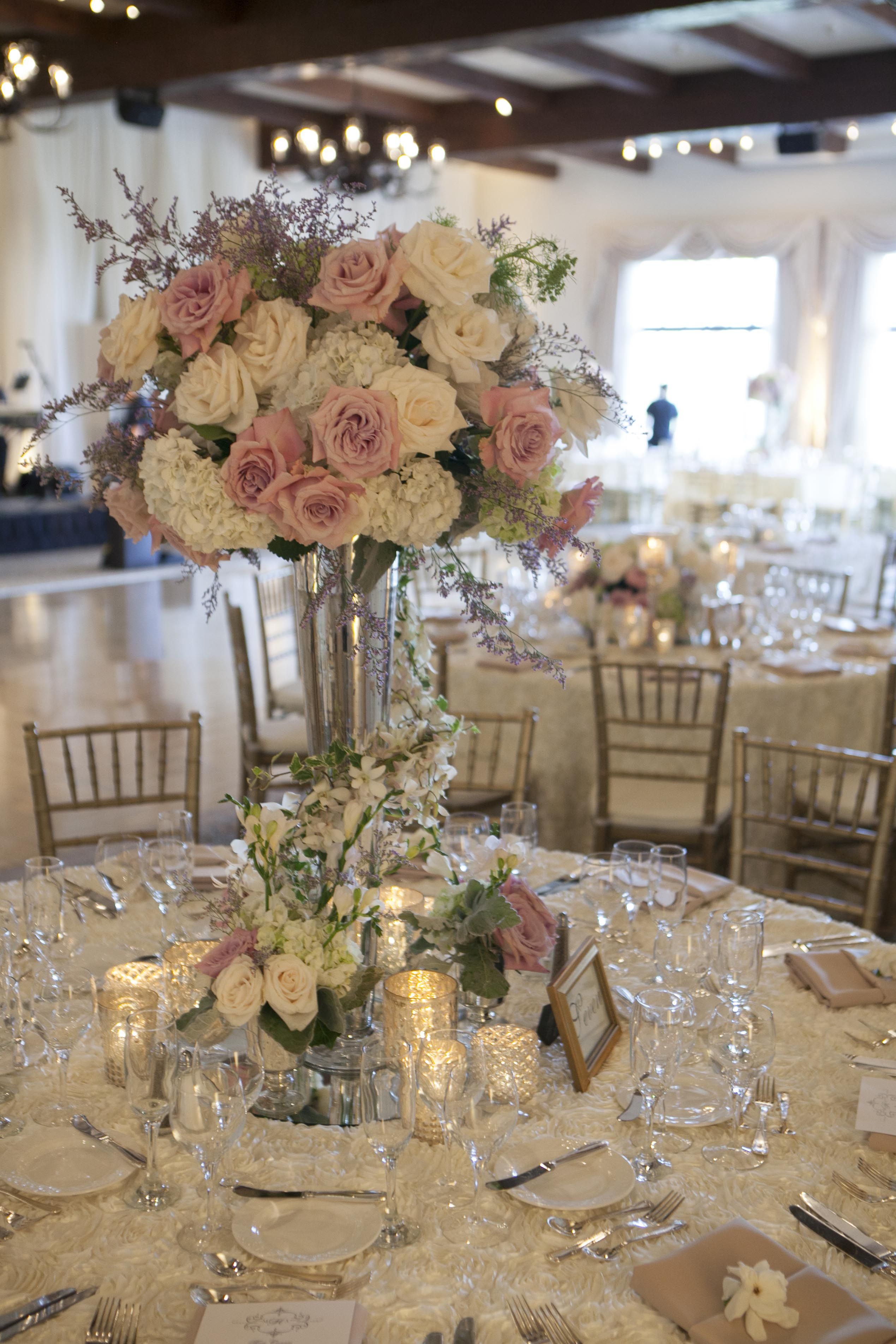 Follow us signaturebride on twitter and on facebook signature at the base of the centerpieces collections of mercury glass votives and small florals including roses freesias dusty miller and variegated ivy filled reviewsmspy