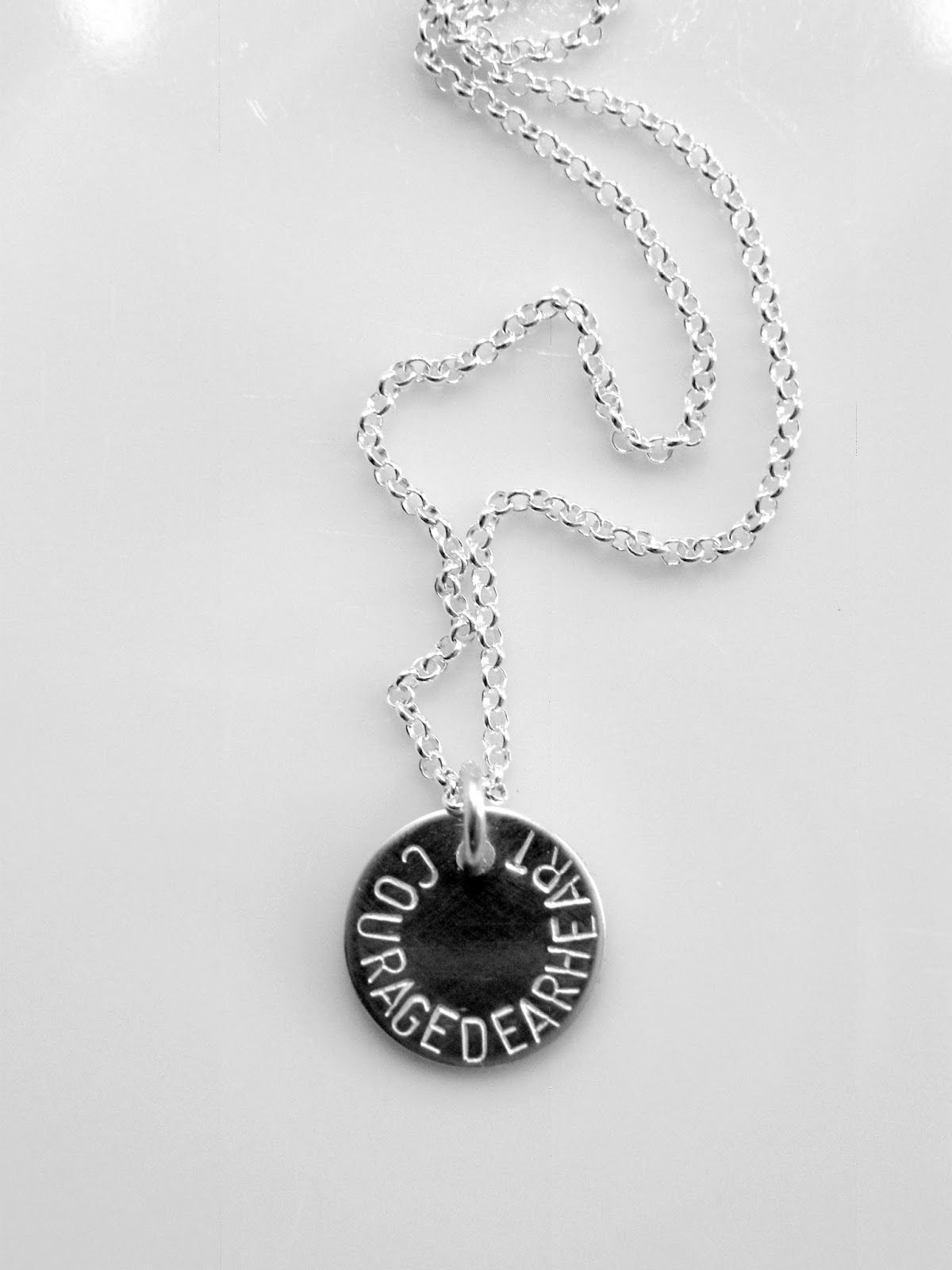 """Courage, dear heart."" -C.S. Lewis.  Silver necklace."