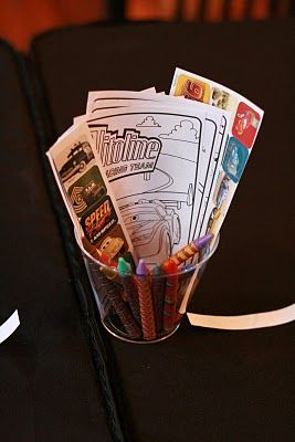 Cups filled with stickers crayons coloring pages etc Cars