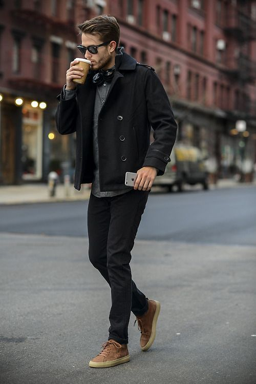 black jeans, a black coat, a grey tee, brown shoes