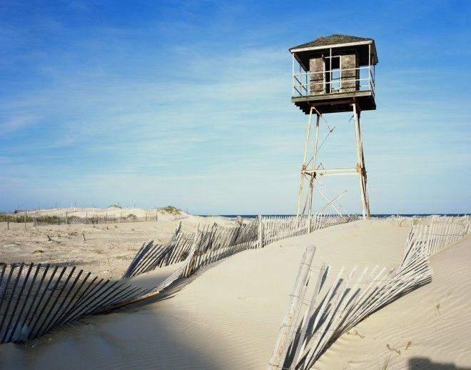 North Carolina, Outer Banks, old watchtower at edge of beach