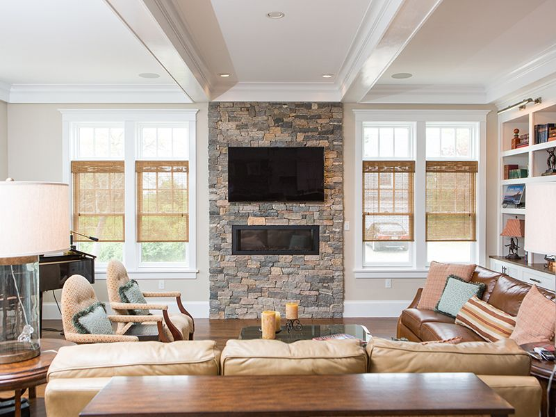 New England stone fireplace in a contemporary space STONEYARD