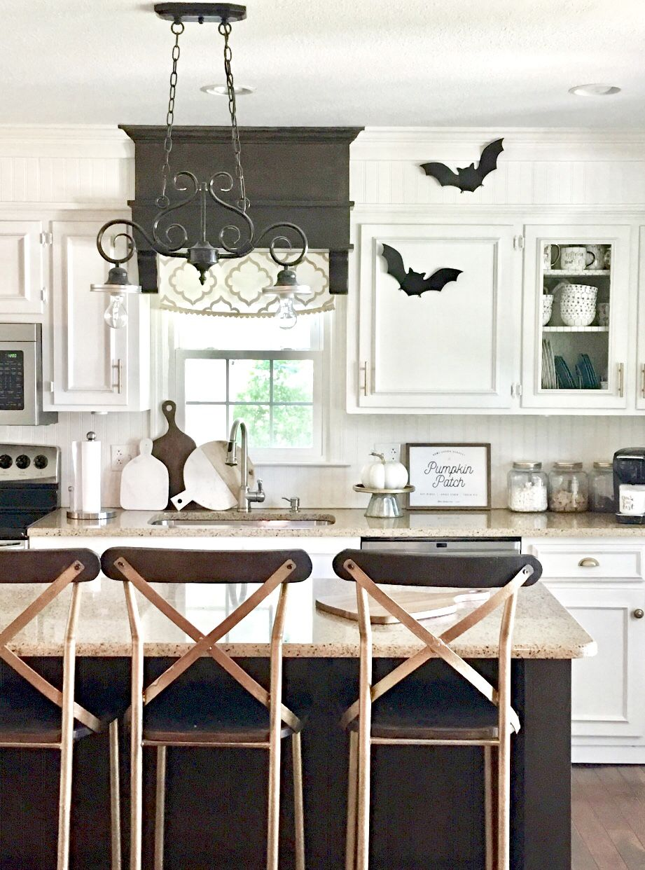Modern farmhouse kitchen White cabinets with dark stained
