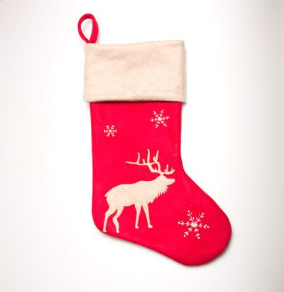 This Red Reindeer Christmas Stocking features a white reindeer and three white snowflakes Made from soft touch polyester this stocking has a white