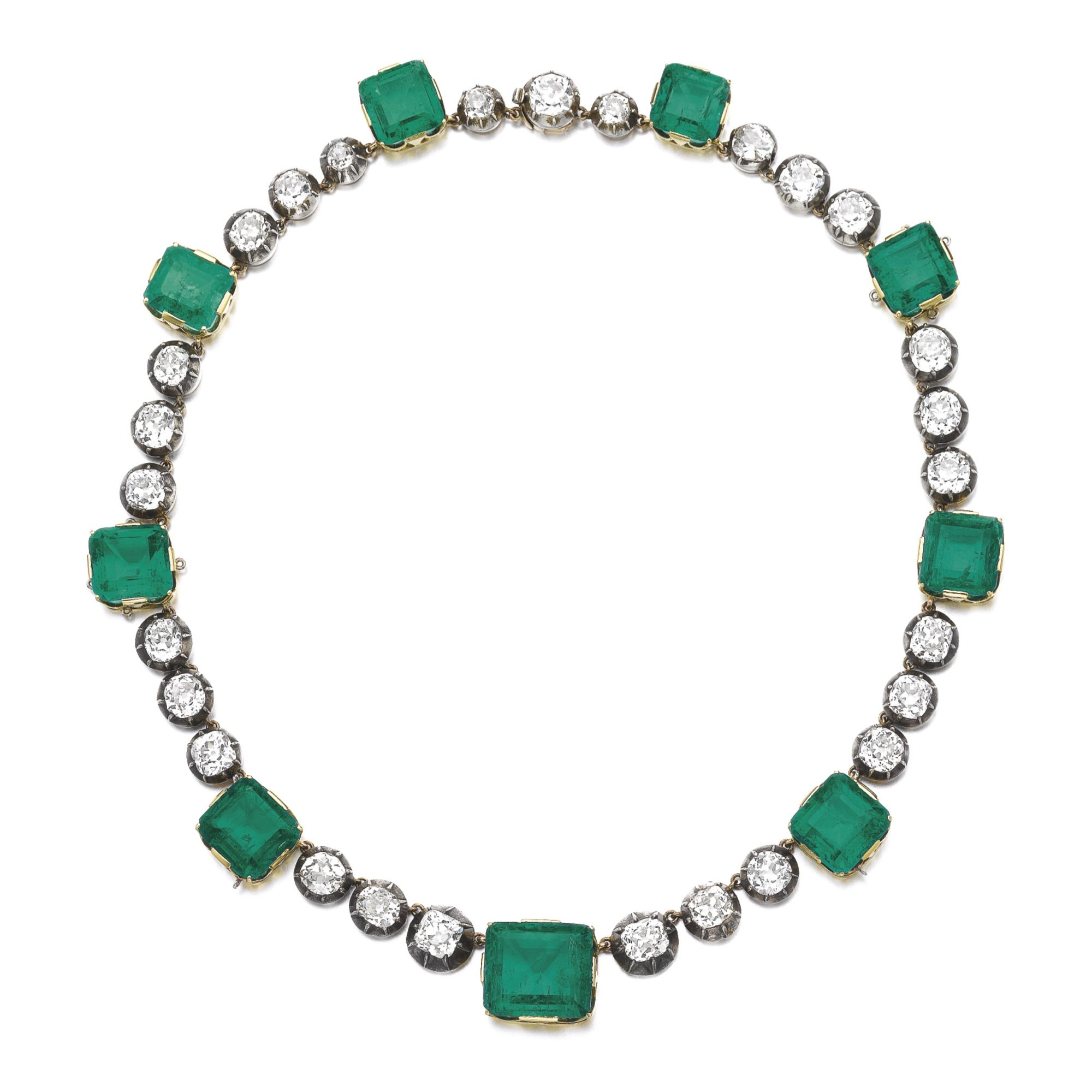 Attractive emerald and diamond necklace, late 19th century and later Composed of a line of pinched collet-set circular-cut and cushion-shaped diamonds, and step-cut emeralds, length approximately 385mm, case signed Janesich.