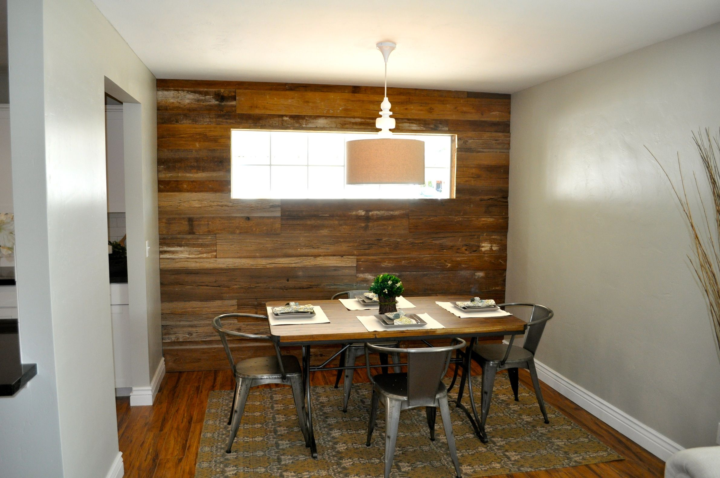 Barn wood accent wall by Rafterhouse New House