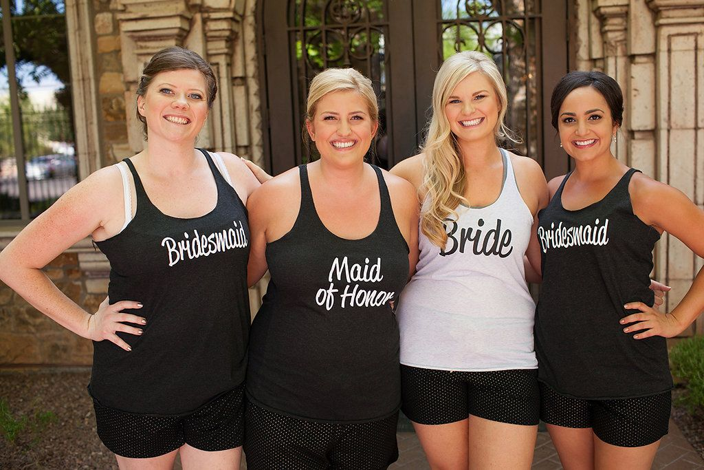 The bride with her bridesmaids and maid of honor in custom made black and white tank tops before the ceremony   Ace Fanning Photography   villasiena.cc