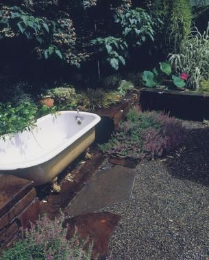 Claw foot tub becomes a water feature, vessel for planting, or just a place to cool off!
