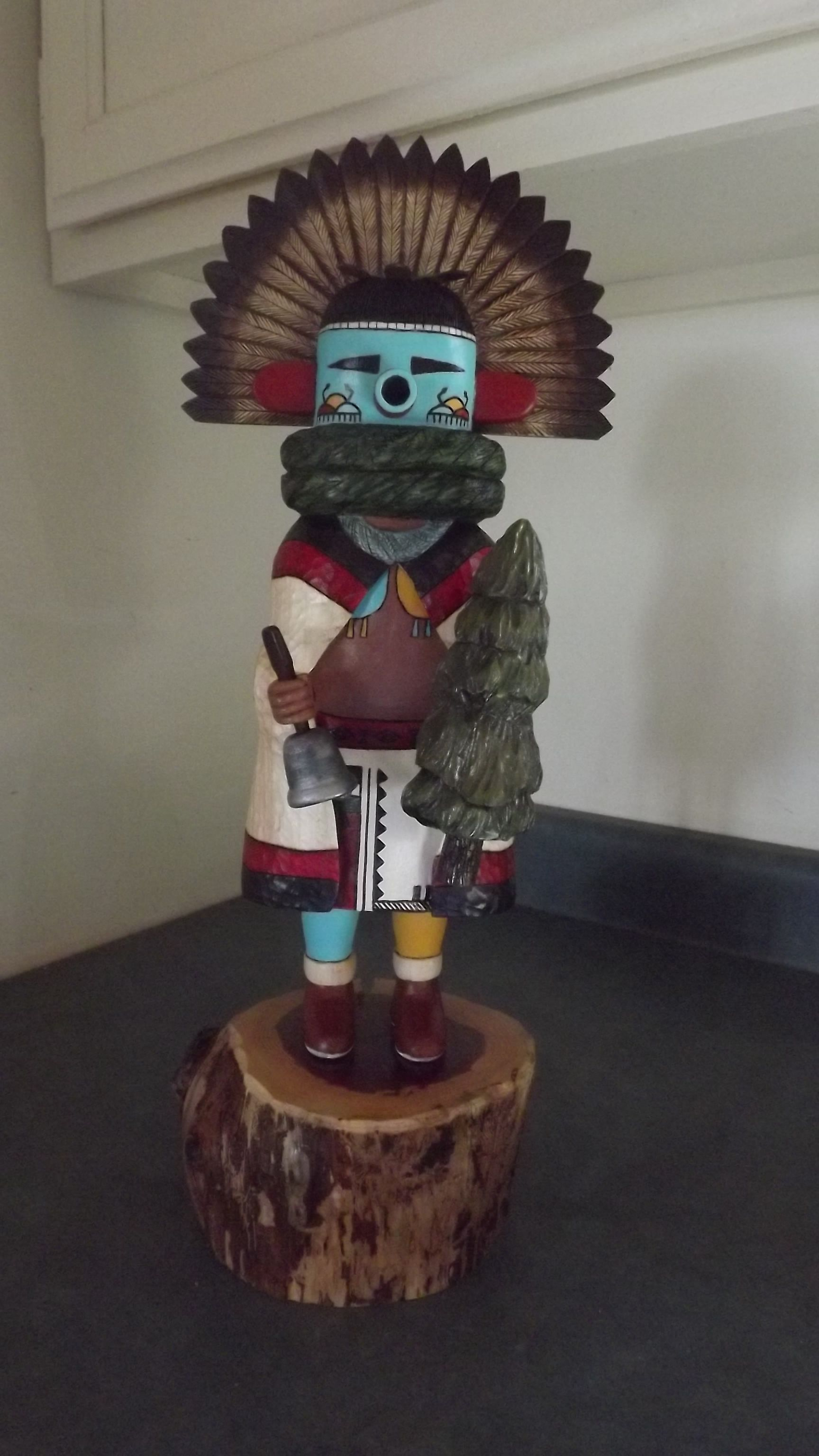 """Recent finished carving for the Quincy Art Show-- Hopi Morning Singer Katsina (Kachina) Tavalai 18"""" tall x 8"""" wide- Seen during the Powamu ceremony(bean planting festival). Found on the rooftops in the early morning to wake the village, would also participate in the dances with the other kachinas and encourage them to join in songs."""