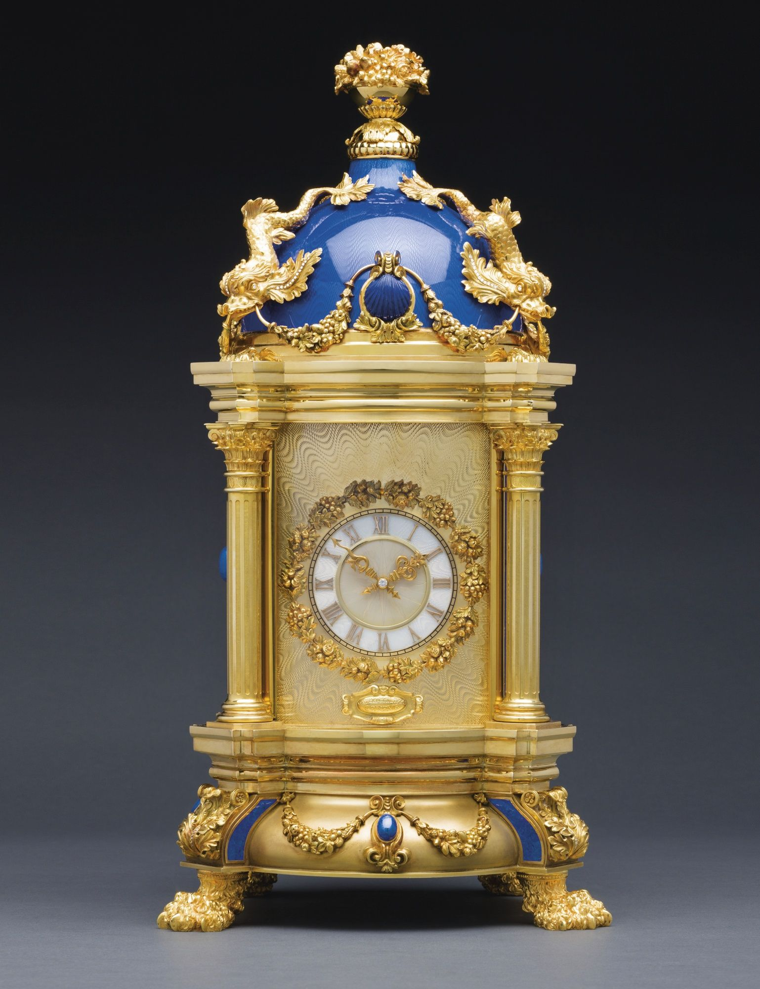 """PATEK PHILIPPE """"THE ROYAL BLUE - MASTERPIECE DOME CLOCK"""" AN EXTRAORDINARY AND MAJESTIC BAROQUE STYLE YELLOW GOLD, SILVER, DIAMOND, LAPIS LAZULI AND TRANSLUCENT ROYAL BLUE ENAMEL EXHIBITION QUALITY DOME CLOCK MADE IN 1980 REF 1191 MVT 11534 CASE 1803537"""