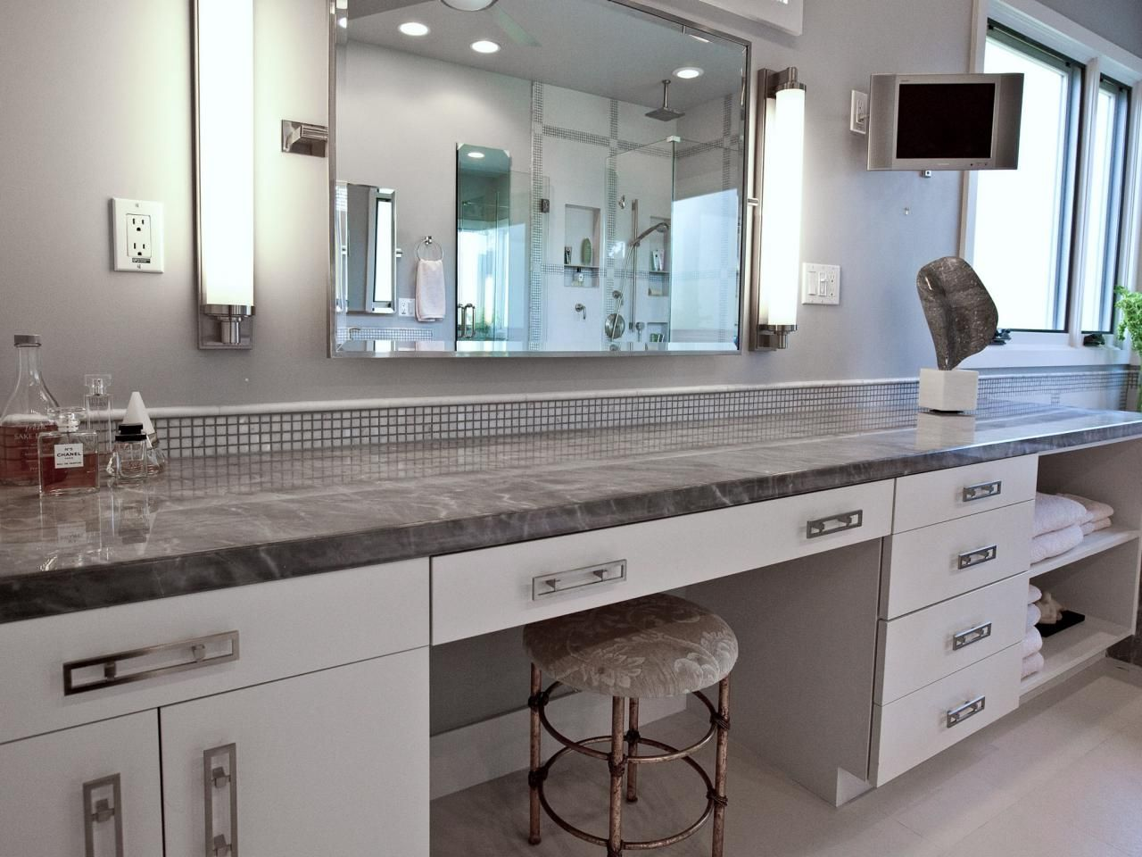 This Modern Bathroom Features A Long White Vanity With A Gray