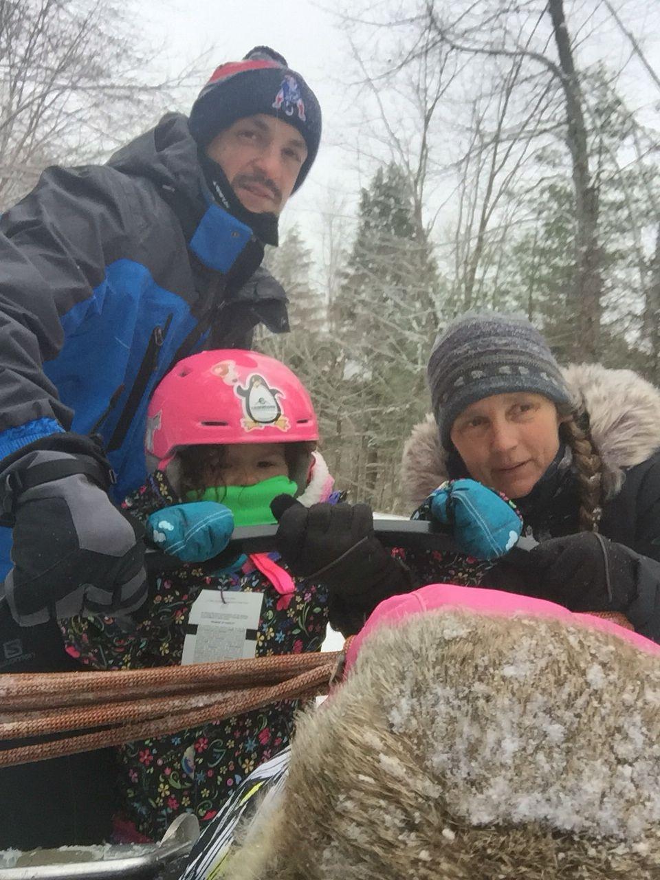 Dakota mushing the sleigh for the dog sled team