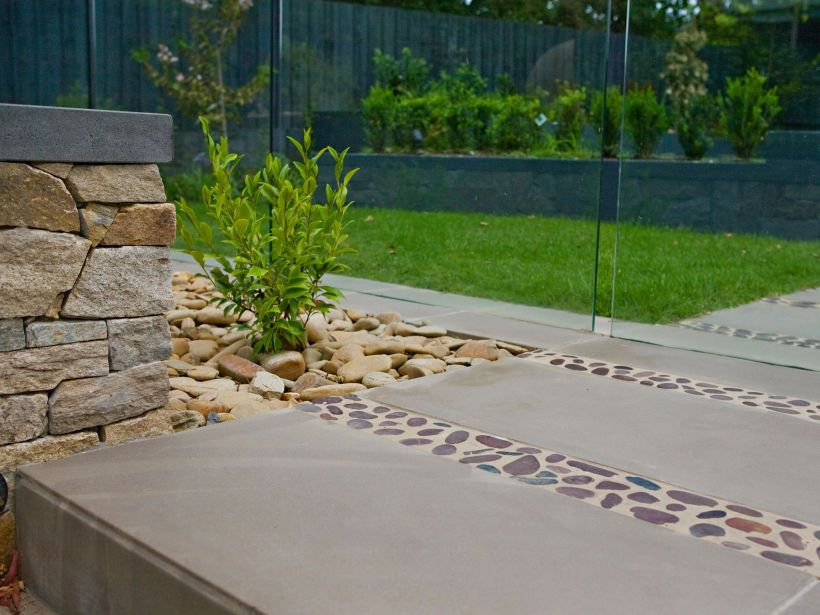Eco Outdoor Concrete Pavers Used In Combination With Bracken Pebbles And  Alpine Dry Stone Walling In Modern Garden Design.