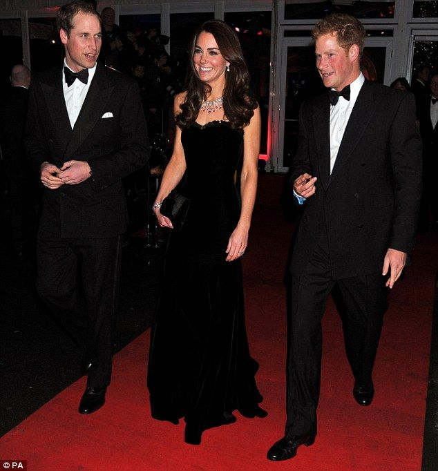 Kate and her men: The Duchess arrives on the red carpet with her husband, Prince William and Prince Harry