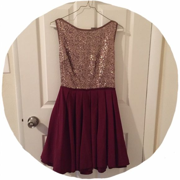 Sequin Dress by Moon Collection Gold/brown sequin too with stunning maroon bottom - this dress is a stunner at any party! Bought at a boutique in NYC and only wore once for my company Christmas party. 100% polyester. Fits 2-6/8. Fitted at waist with room for larger hips Moon Collection Dresses