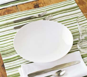 A generously sized place mat in a graphic pattern serves up visual interest in a minimal arrangement.
