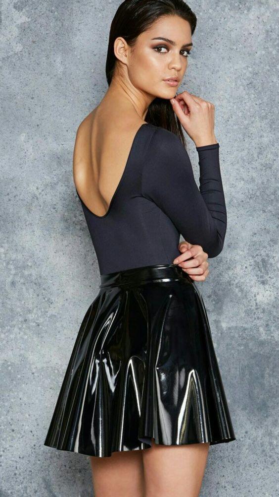 ecd96f01760f Black patent vinyl skater skirt worn with black leotard with scoop neckline  in back.