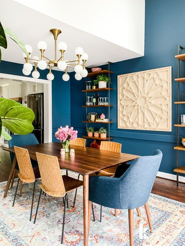 The new mid-century modern furniture for our eclectic navy blue dining room arr
